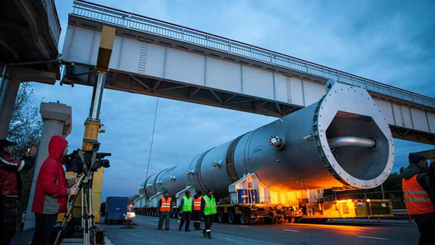 Raising a pedestrian bridge for 2 meters over M-53 federal highway for passing a road train with reactors for the Achinsk Refinery. Bridge weight — 30 tonnes, length — 39 meters. The bridge was returned to its original position with the accuracy up to 1 millimeter